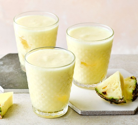 Pineapple smoothie in three small glasses