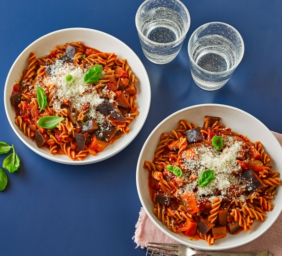 Two bowls of pasta arrabbiata with aubergines
