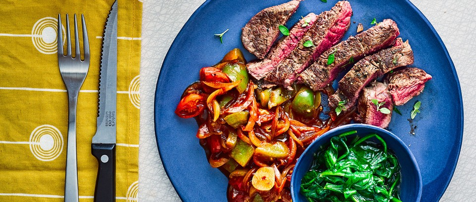 Steaks with goulash on plate