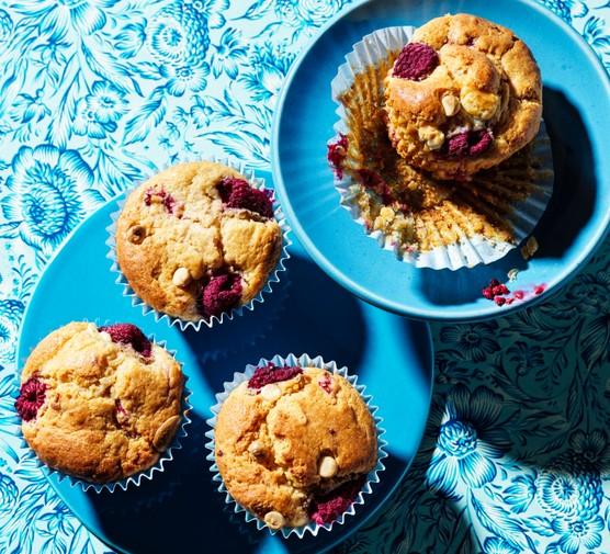 Raspberry muffins on blue plates