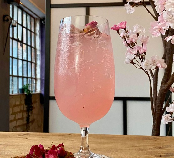 Akaibara cocktail in glass with rose petals