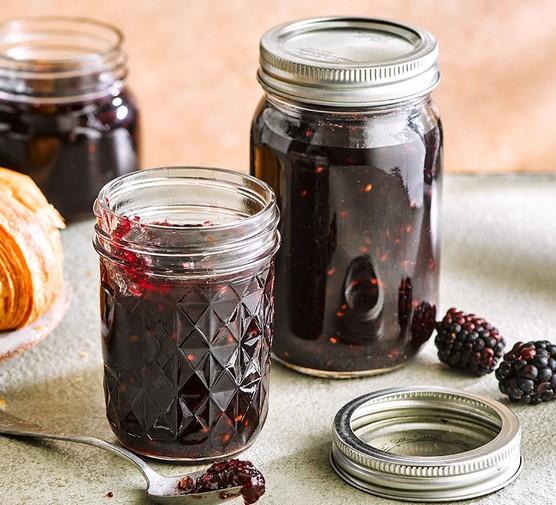 Apple and blackberry jam in jars