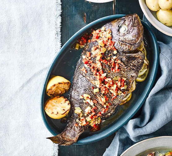 Barbecued bream with spring onions, lemon & chilli served on an oval dish