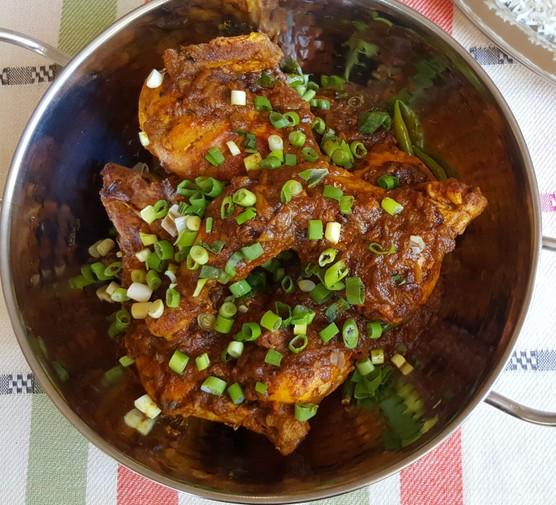Roast chicken in bowl with garnish