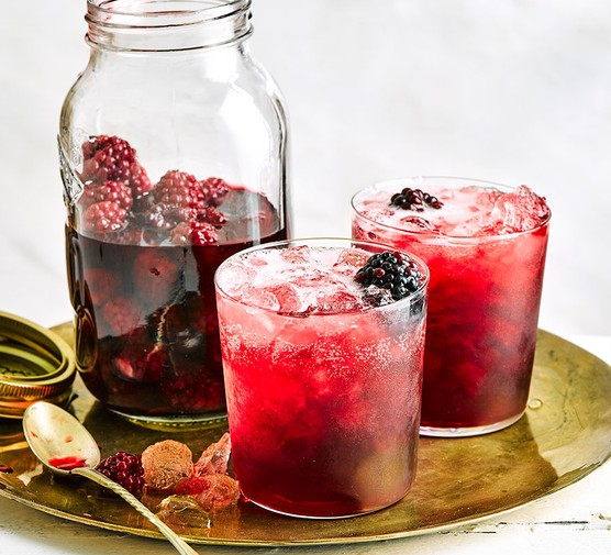 Blackberry Vodka in a bottle and 2 glasses
