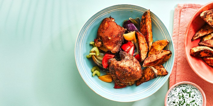 Cajun chicken and sweet potato chips in a blue bowl