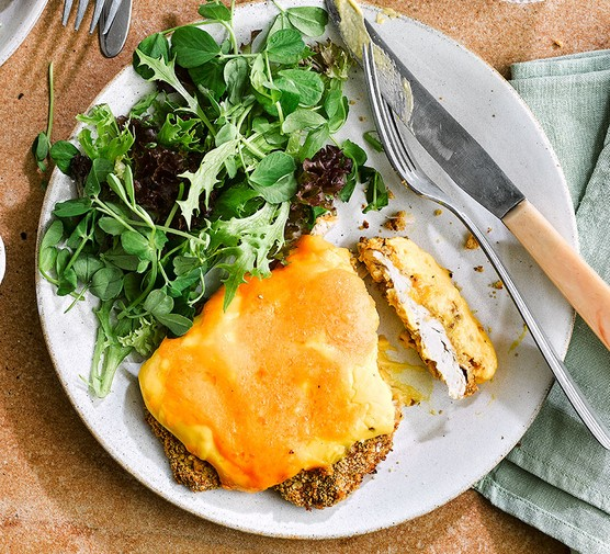 Chicken parmo served with salad