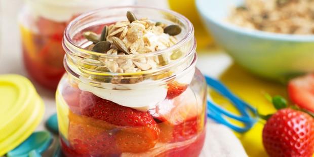 Strawberry jars topped with yogurt and granola