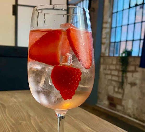 Cocktail in glass with strawberries