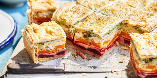 Vegetable layered pie cut into square slices