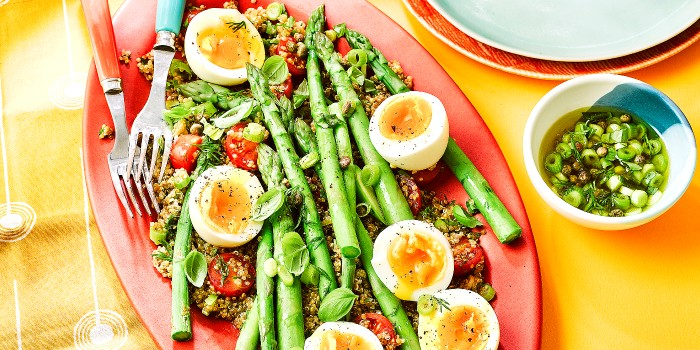 Asparagus and eggs on a bed of quinoa