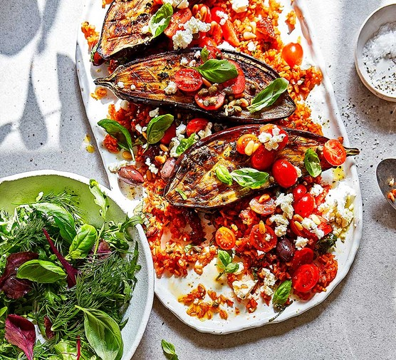 Roast puttanesca aubergines with tomato rice & feta on an oval dish