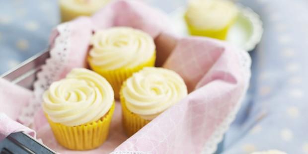 Vanilla cupcakes in gold cases