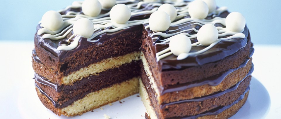 A striped chocolate cake with chocolate icing