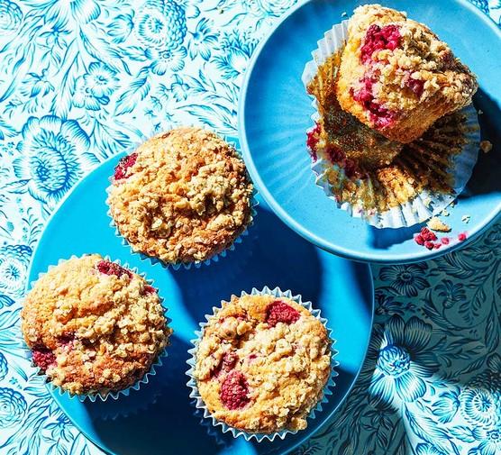 Four raspberry & white chocolate crumble muffins