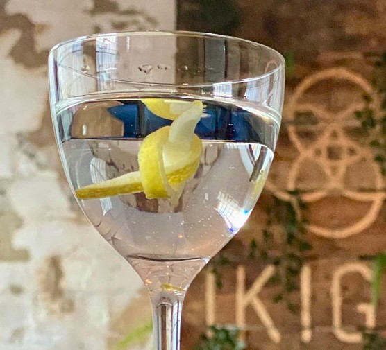 Martini in a glass with lemon peel garnish