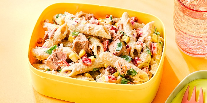 A pasta and tuna salad in a yellow lunch box