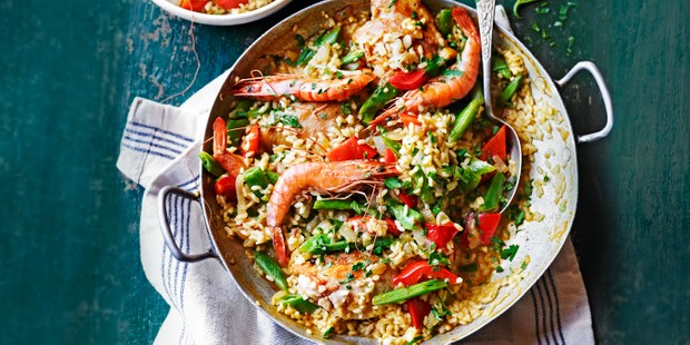 Prawn and runner bean paella in a wide dish