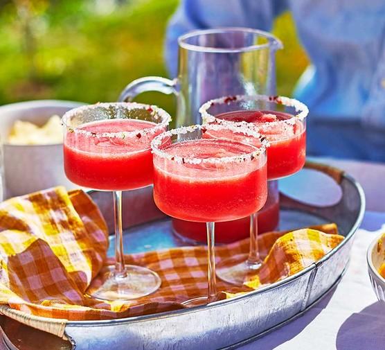 Four glasses of frozen watermelon margarita on a platter