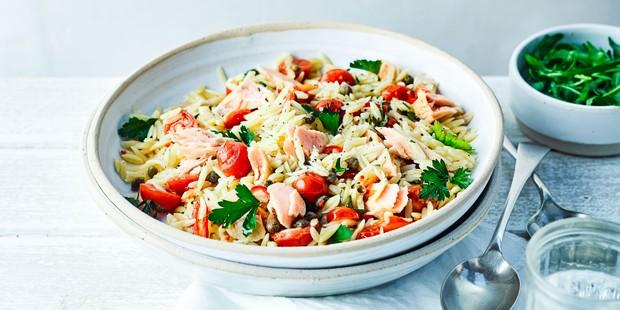 Bowl of tuna, orzo, tomato and caper salad