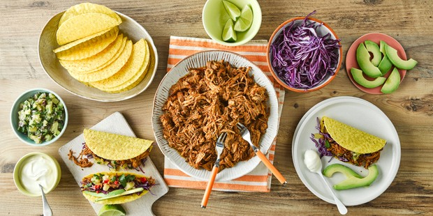 Bowl of pulled pork with tacos and pineapple salsa
