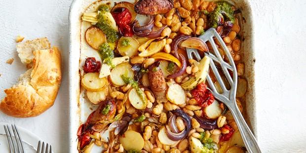 New potato, sausage, pesto, bean and tomato traybake