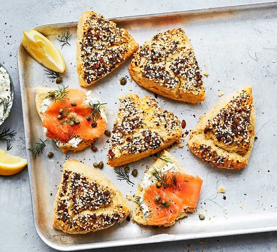 Seedy scones with smoked salmon on a baking tray