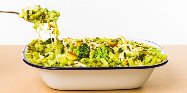 Tub of Mac n cheese with broccoli and other greens