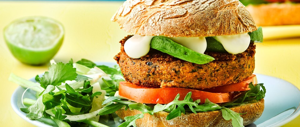 Bean burger on plate with salad