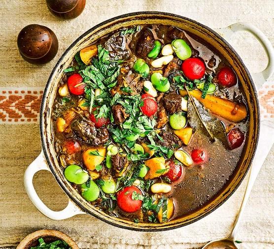 Beef estofado in a casserole pot