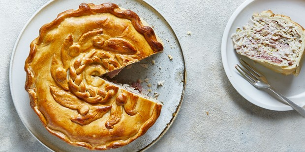 Turkey and ham pie with pastry decoration on top