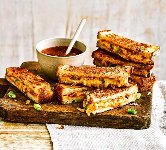 Mango chutney campfire cheese toasties on a wooden platter