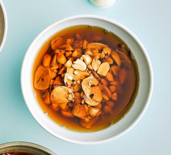 Peanut, chilli & garlic oil in a small bowl