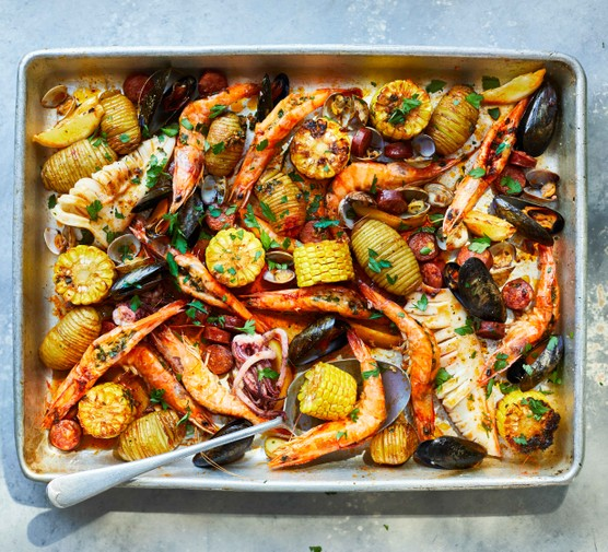 Roast seafood dish in a silver baking tray