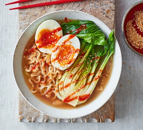 Sesame ramen with pan choi and eggs in a bowl