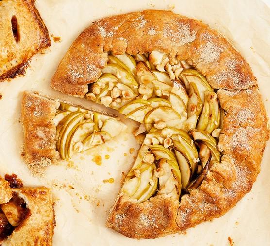 Apple & hazelnut galette with a slice cut away