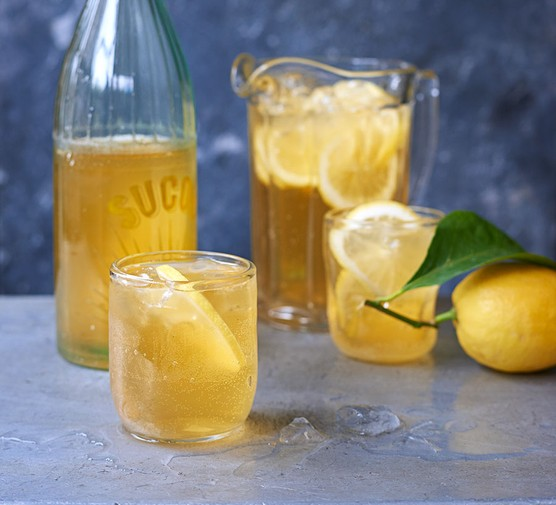 Funky fermented ginger lemonade in a bottle and small glass