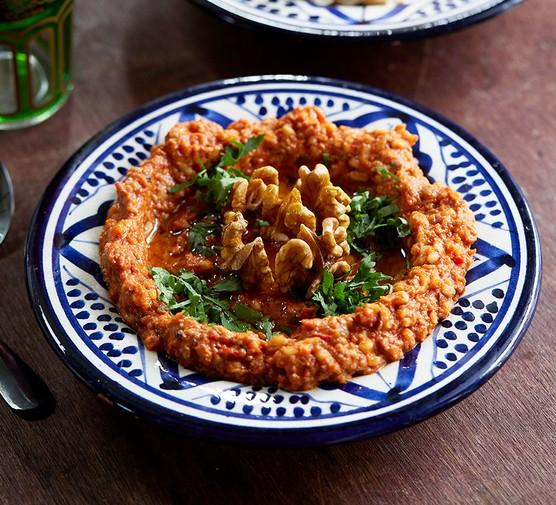Muhammara dip served in a decorative dish