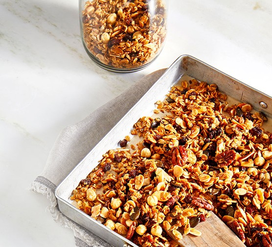 Nuts and seeds granola on a baking tray