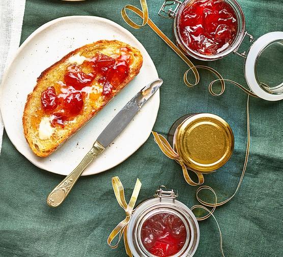 Peach jam in jars and spread on toast
