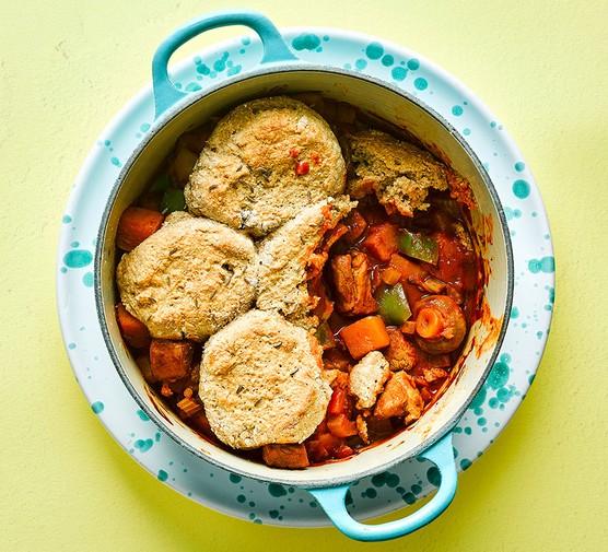 Pork & squash goulash cobbler in a casserole dish