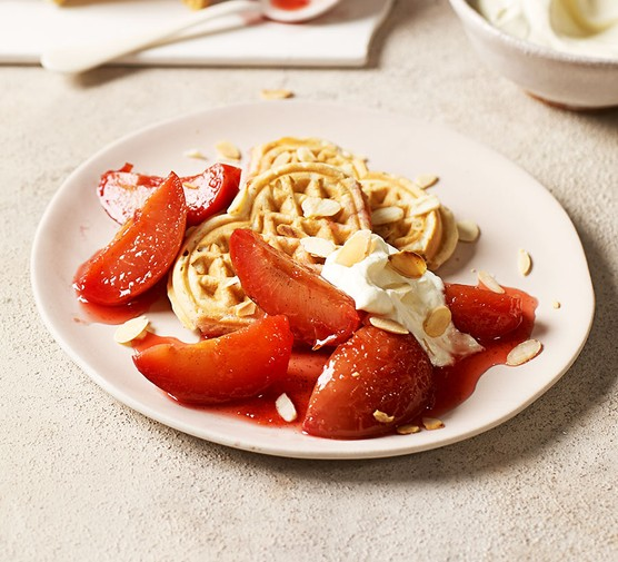 One serving of Belgian waffles with plum compote & amaretto cream