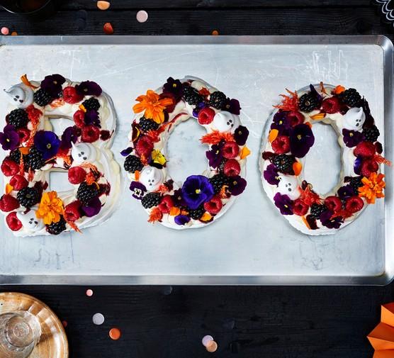 Pavlova with berries, edible flowers and ghost meringues