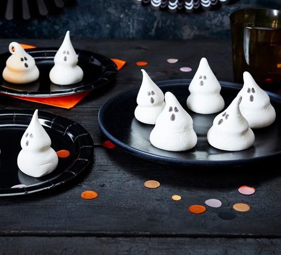 Meringue ghosts on plates