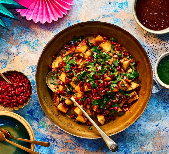 Aloo chaat in a bowl with a spoon