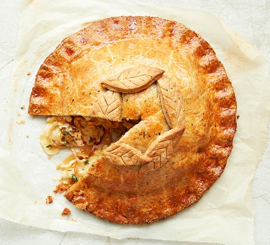Cheese & onion pie with a piece cut out
