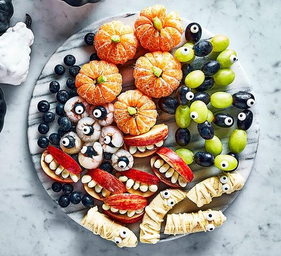 Freaky fruit platter on a marble serving board