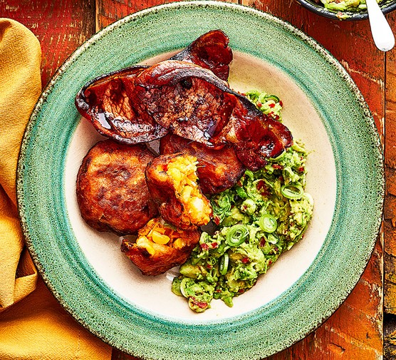 A serving of sweet potato & corn cakes with tamarind bacon & avocado
