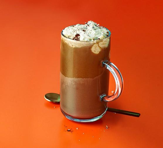 Vegan chai hot chocolate in a tall glass