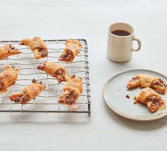 Cinnamon, raisin & walnut rugelach pastries on a wire rack